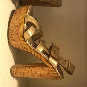 Gold Bebe strappy heel